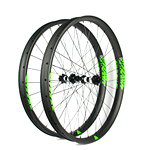 Hand-built carbon mountain bike 29er plus wheels 50mm wide beadless tubeless compatible