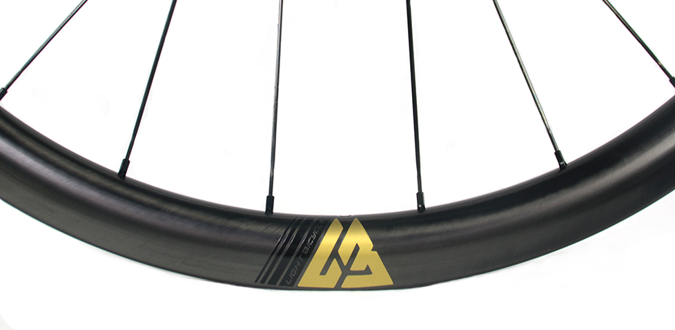 golden decal on light bicycle premium wheels