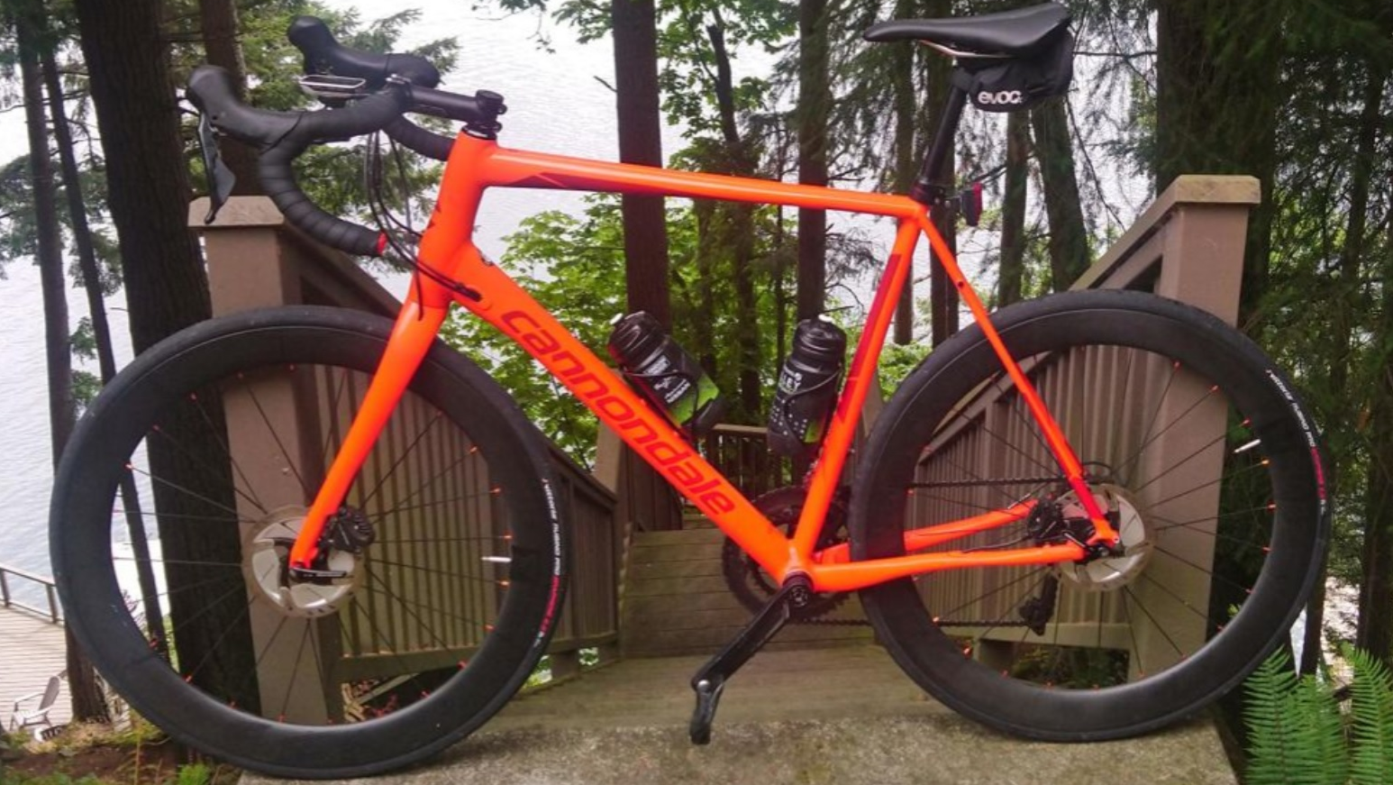 Cannondale-anodized-orange-road-disc-frame-with-56mm-carbon-wheels
