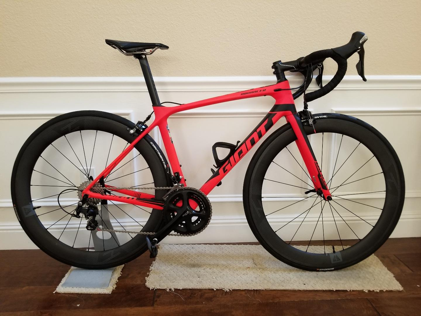 Light-Bicycle-AR56-carbon-wheels-on-Giant-advanced-2-frame-neon-red