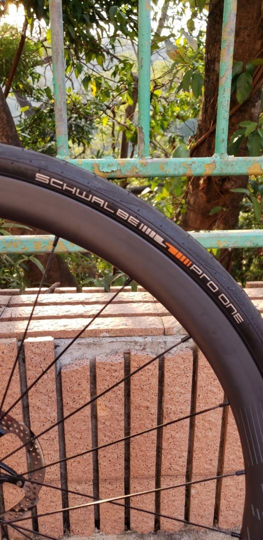 schwalbe-pro-one-25mm-tubeless-tires-light-bicycle-carbon-rims-grey-decal-disc-brake