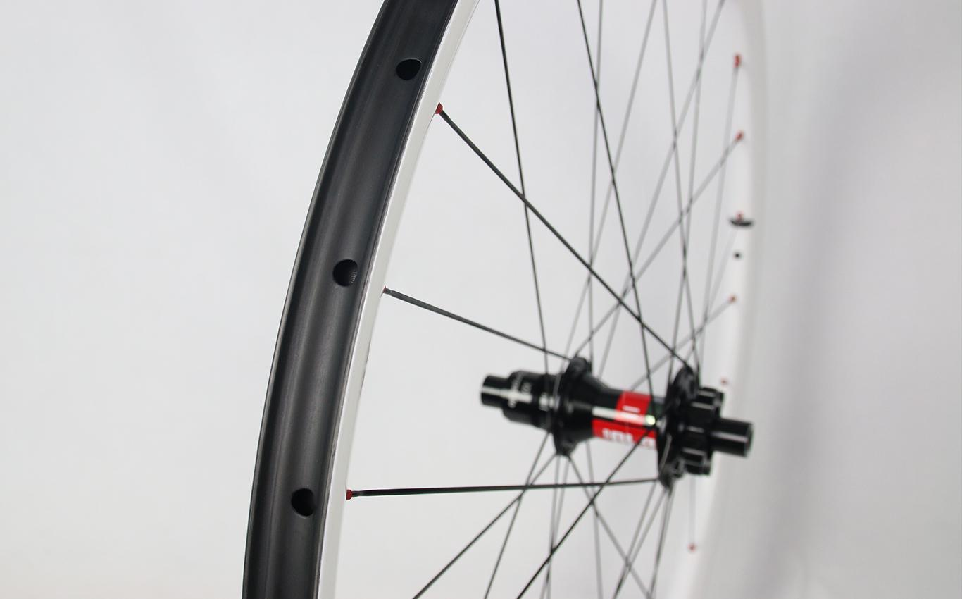 light-bicycle-rm29c06-painted-white-carbon-rim-laced-to-dt-swiss-240-classic-mtb-hub-rear-xd-driver