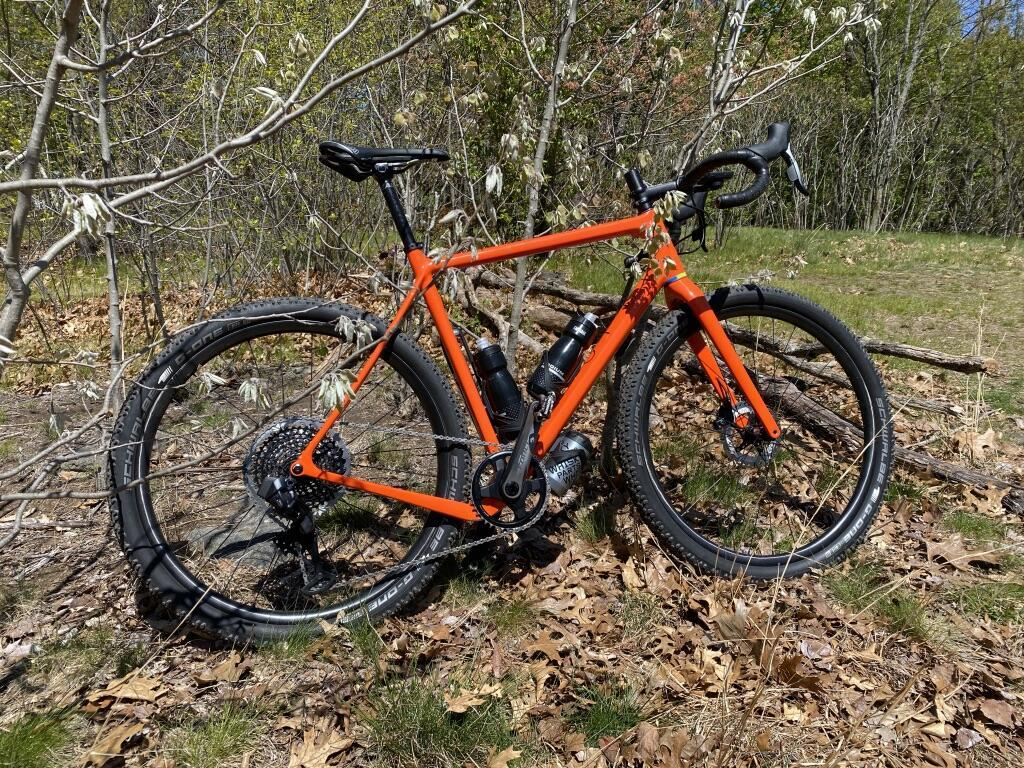 Light-Bicycle-paintless-XC725-flyweight-cross-country-carbon-wheelset-with-schwalbe-g-one-tires-on-orange-gravel-bike-frame