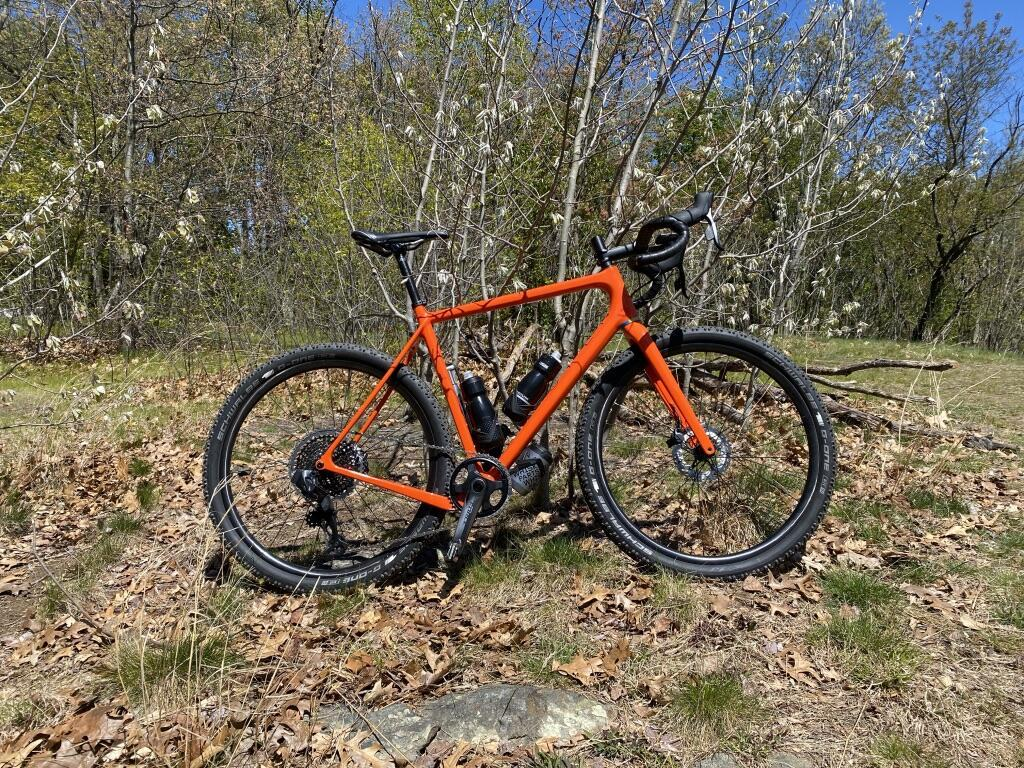 orange-gravel-bike-with-light-bicycle-xc725-650b-flyweight-carbon-wheelset-and-schwalbe-g-one-tires