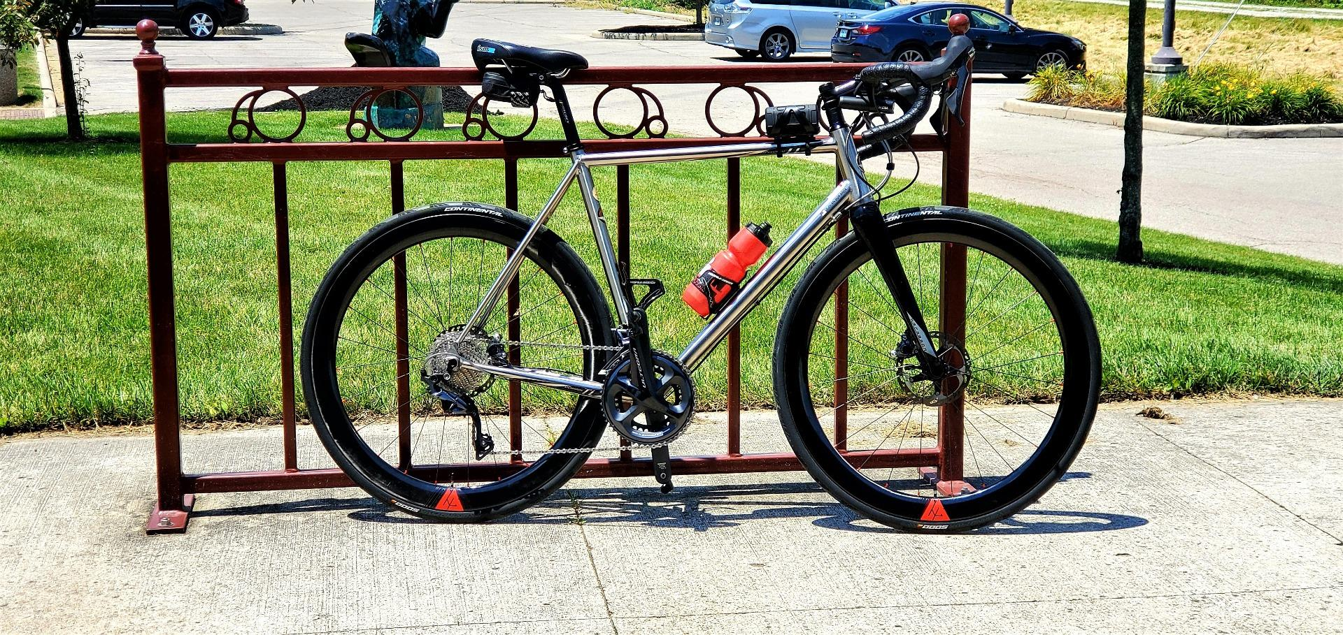 700c-carbon-fiber-wide-road-rims-with-red-valve-decals-on-GP5000-clincher-tires-with-ultegra-crankset