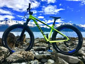 trek-mountain-bike-by-river-under-blue-sky