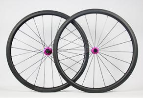 light-bicycle-r35-carbon-rims-laced-to-chris-king-r45-road-hubs-matte-punch-pink